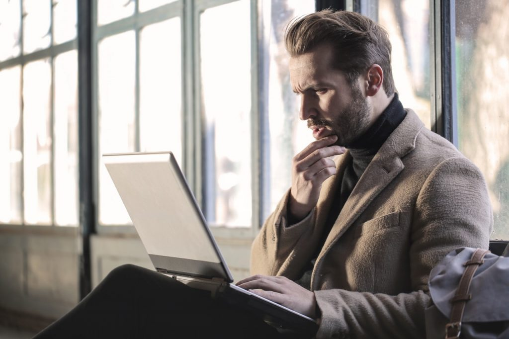 Don't confuse customers by being irrelevant. Image shows man staring at laptop screen with a very confused look on this face.