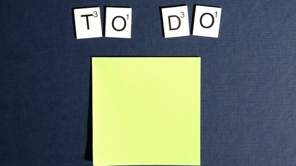 Create a content marketing strategy for your small business. Image shows a yellow post it note and the words To Do
