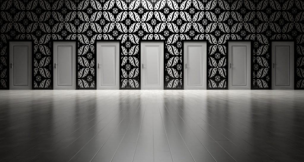 What are your customers looking for from content from your business? Images shows a series of white doors in a wall with black and white wallpaper and a shiny white floor.