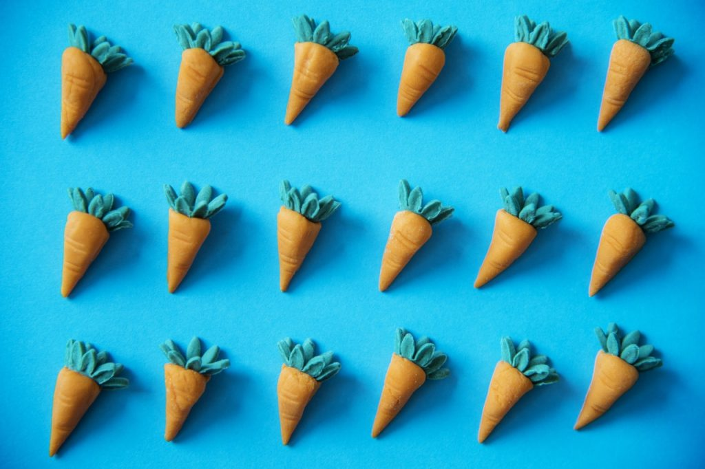 Why big businesses are copying smaller ones. Image shows three rows of identical carrot models