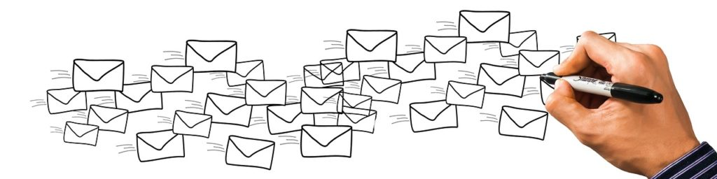 Image shows lots of envelopes to illustrate the point about how many blogs and newsletters are emailed out each day