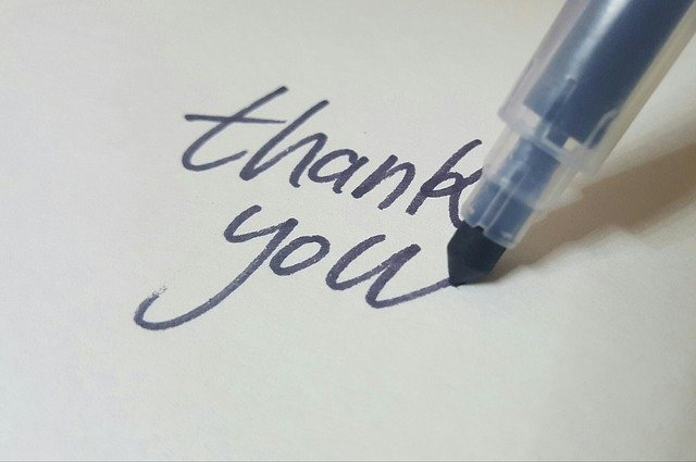 Thank you to all my copywriting and brand storytelling clients. Image shows the words thank you being written by a felt tip pen.