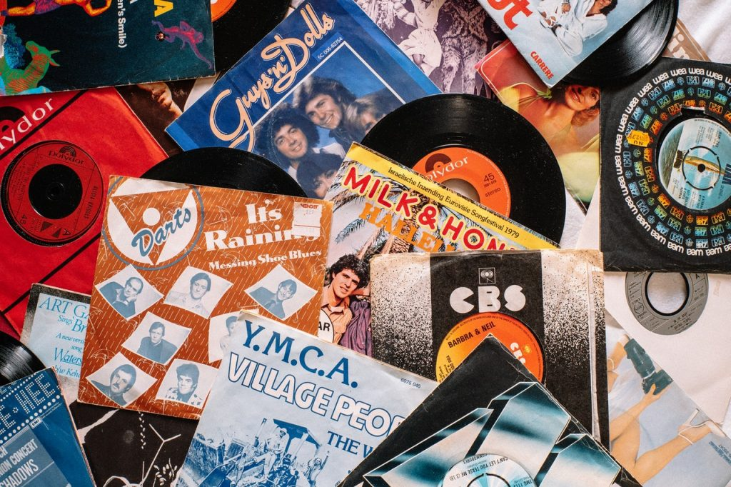 Image shows a selection of vinyl records and record sleeves from the 1980s