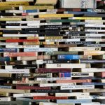 Do you have tsundoku habit?Image shows lots of books arranged in a wall with gaps in between