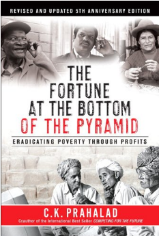 Image shows the book cover of The Fortune at the Bottom of the Pyramid. It has black and white photos of people.