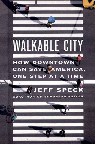 "Image shows a zebra crossing from above with people crossing it. Book cover of ""Walkable City"""