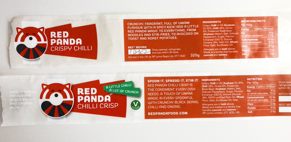 The smallest space, front and back. Image shows the front and back, old and new, labels for Red Panda