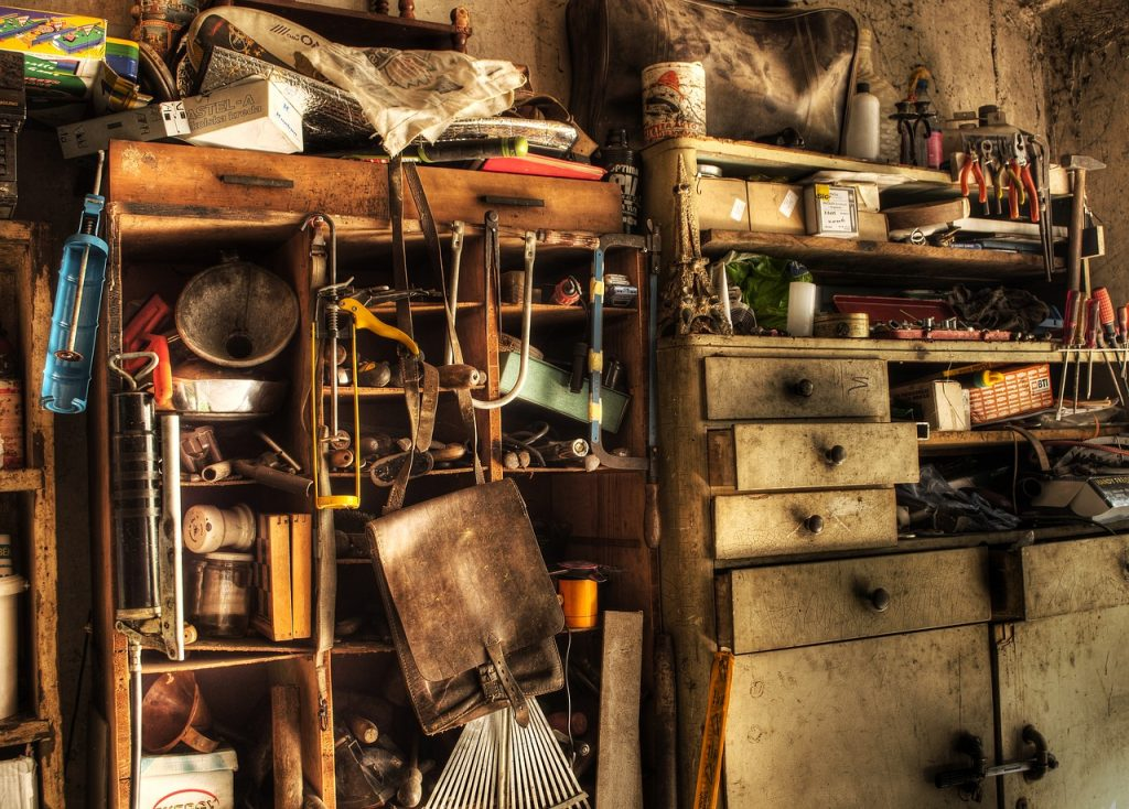 Image shows a dusty collection of ephemera, typical of many garages or understairs cupboards. Make sure you collect your stories and use your stories
