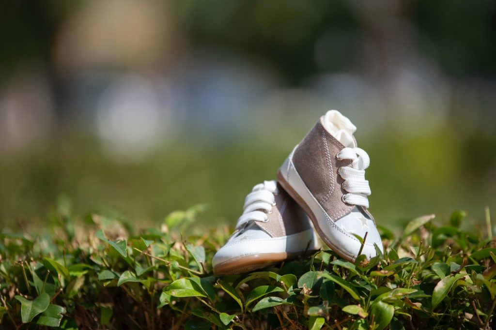 Image show a pair of baby shoes. Even the shortest story can invoke our hormones.
