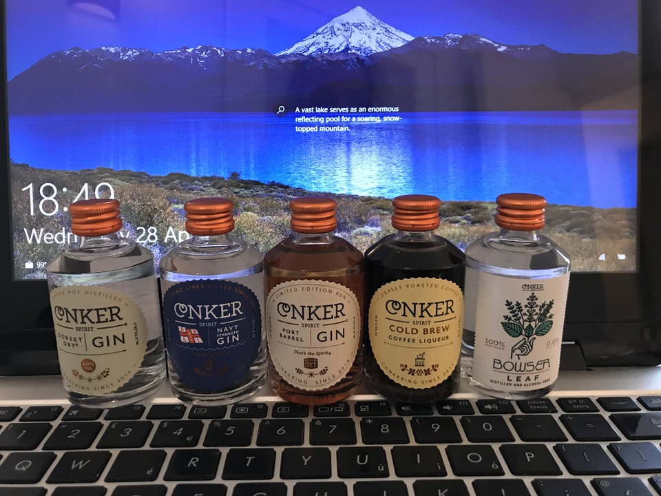 Image shows a row of Conker Spirits miniatures in front of a computer screen.