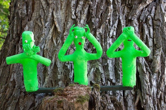 Image shows three green figures doing say no evil, hear no evil, see no evil. Make like there is no football
