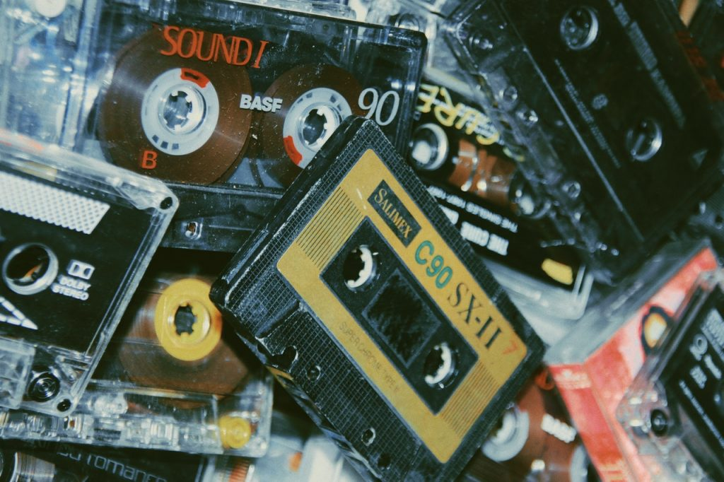 Image shows a pile of old cassettes. A format and technology that is dated and in need of a refresh.