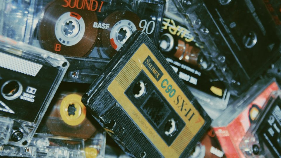 Image shows a pile of old cassettes