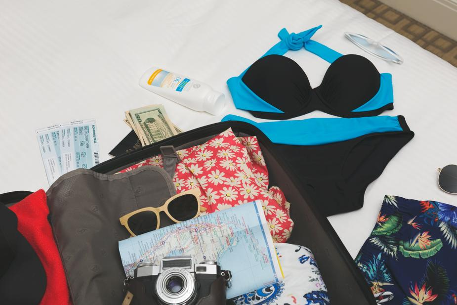 Image shows summer holiday paraphenalia such as a book, camera and sunglasses. Not thinking is a mini vacation