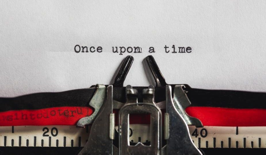 image shows text being typed on an old typewriter. It says once upon a time. Why storytelling is always important to businesses